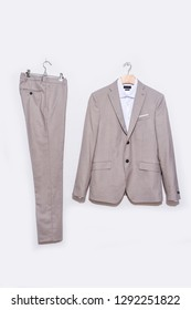 Classic suit, white shirts and pants on hanging