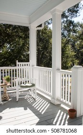 Classic Sunny Southern Porch surrounded by Live Oak Trees
