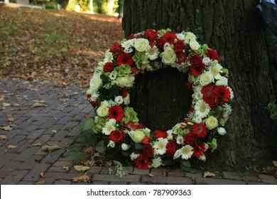 Classic Sympathy wreath near a tree at a cemetery