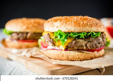 Classic tasty hamburger with tasty beef and sauce on dark background. American food