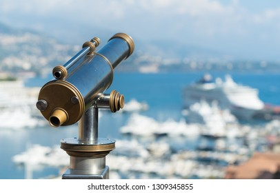 classic telescope for tourists in Monaco viewing over the main port