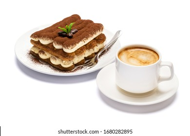 Classic tiramisu dessert on ceramic plate and cup of coffee isolated on white background with clipping path