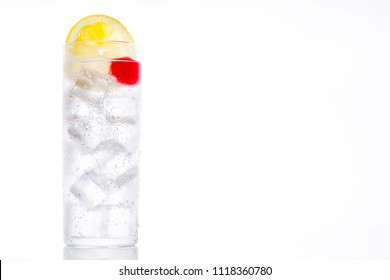 Classic Tom Collins cocktail on white background. Copyspace