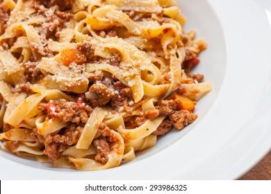 A classic traditional Italian dish, ragu all bolognese, with tagliatelle in a white bowl