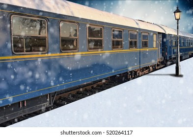 Classic train on snowy platform with lantern in winter
