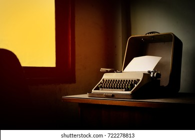The Classic Typewriter on desk in dusty room, vintage object.
