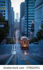 Classic vertical view of historic Cable Car riding on famous empty California Street in beautiful early morning twilight before sunrise in summer, San Francisco, California, USA