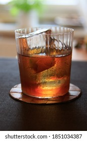 Classic Vieux Carre cocktail with Cognac, Rye Whiskey, herbal liqueur and bitters in an Old Fashioned glass with clear ice cubes