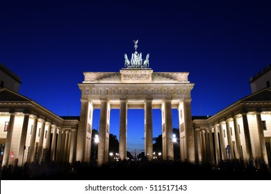 Classic view of famous Brandenburg Gate, Berlin - Germany's most famous landmark and a national symbol, in twilight during blue hour at dawn
