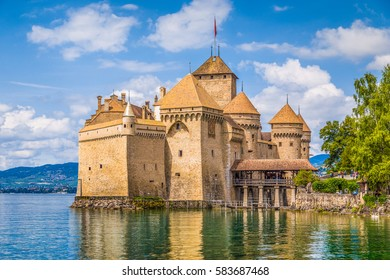Classic view of famous Chateau de Chillon at beautiful Lake Geneva, one of Switzerland's major tourist attractions and most visited castles in Europe, on a sunny day in summer Canton Vaud, Switzerland
