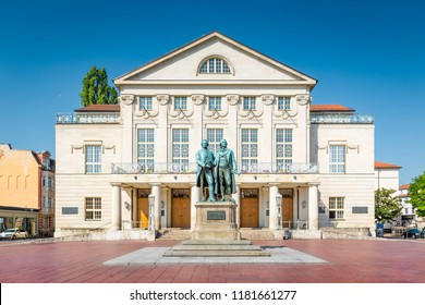 Classic view of famous Deutsches Nationaltheater with Goethe-Schiller monument on a beautiful sunny day with blue sky in Weimar, Thuringia, Germany