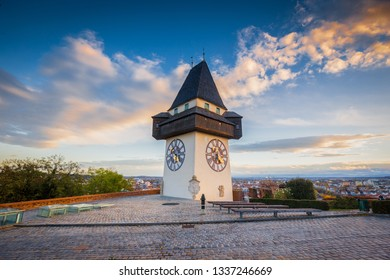 Classic view of famous Grazer Uhrturm in the historic city of Graz in beautiful evening light at sunset, Styria, Austria