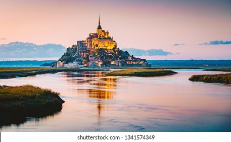 Classic view of famous Le Mont Saint-Michel tidal island in beautiful evening twilight at dusk, Normandy, northern France