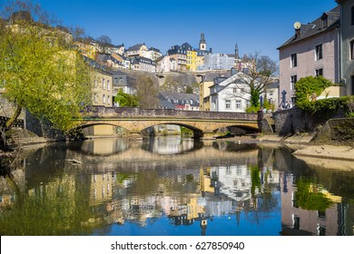 Classic view of the famous old town of Luxembourg City reflecting in idyllic Alzette river on a beautiful sunny day with blue sky in springtime, Luxembourg