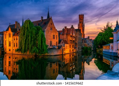 Classic view of the historic city center with canal in Brugge (Bruges), West Flanders province, Belgium. Night cityscape of Bruges.