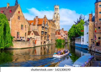 Classic view of the historic city center with canal in Brugge (Bruges), West Flanders province, Belgium. Cityscape of Bruges.
