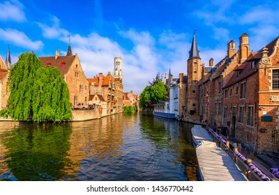 Classic view of the historic city center of Bruges (Brugge), West Flanders province, Belgium. Cityscape of Bruges with canal.