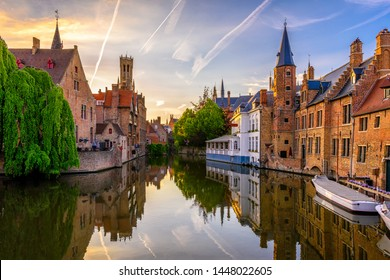 Classic view of the historic city center of Bruges (Brugge), West Flanders province, Belgium. Sunset cityscape of Bruges. Canals of Brugge