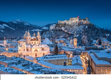 Classic view of the historic city of Salzburg with Salzburg Cathedral and famous Festung Hohensalzburg illuminated in beautiful twilight during Christmas time in winter, Salzburger Land, Austria