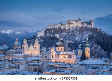 Classic view of the historic city of Salzburg with famous Festung Hohensalzburg and Salzburger Dom illuminated in beautiful twilight during scenic Christmas time in winter, Salzburger Land, Austria