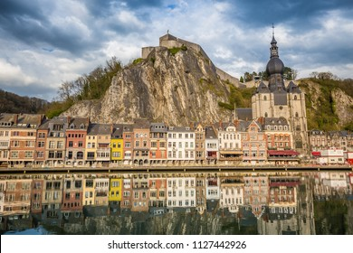 Classic view of the historic town of Dinant with scenic River Meuse in beautiful golden evening light at sunset, province of Namur, Wallonia, Belgium