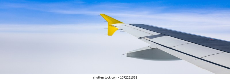 Classic View Image Through Aircraft Window Plane Wing. Panoramic image.