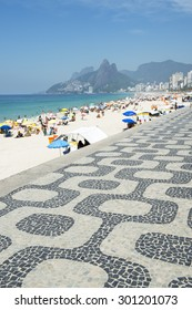 Classic view of Ipanema Beach Rio de Janeiro boardwalk with Two Brothers Mountain under bright blue sky
