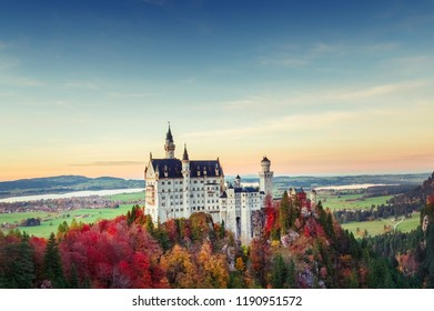 Classic view of Neuschwanstein castlein Germany, Bavaria, Europe. Picturesque autumn landscape, colorful trees, beautiful seasonal fall scene. Famous and popular landmark. Free copy space.