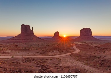 Classic view of scenic Monument Valley with the famous Mittens and Merrick Butte in beautiful golden morning light at sunrise in summer with retro vintage Instagram style filter effect, Arizona, USA