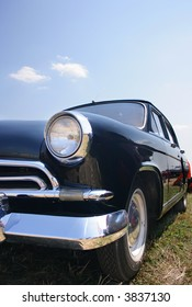 Classic and vintage cars - classic black car against a blue sky