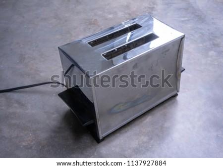 Classic Vintage Chrome Toaster On Concrete Stock Photo (Edit Now