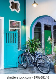 Classic vintage city bicycle with colorful Chino-Portuguese architecture in Phuket, Thailand