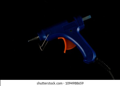 Classic vintage Electric hot glue gun pistol isolated