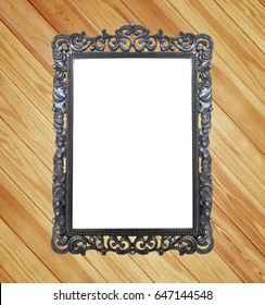 Classic vintage frame with wooden wall.
