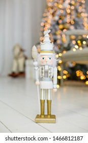 Classic vintage nutcracker on New Year background. Wooden toy nutcracker, classic decorations. Vintage New Year symbol. Christmas mood in children room