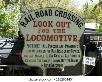 A classic, vintage railroad crossing sign warned travelers to look out for the locomotive.