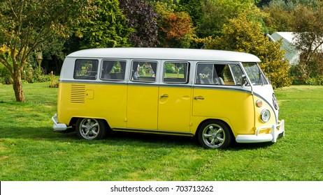 Classic vintage yellow Volkswagen Transporter camper van parked in the park, Devon, UK, August 26, 2017