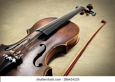 Classic violin on grunge paper texture.