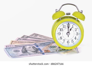 Classic Watch with a dollar. model on dollar banknote, concept and idea of time value and money, realestate business and finance concepts. retro green alarm clock with the hands at 10 am or pm