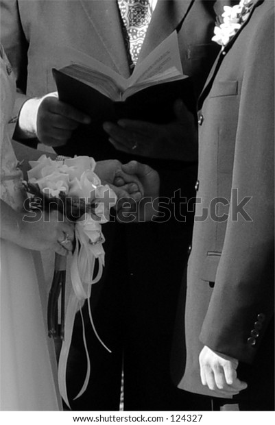 Classic wedding in black & white.  Note hesitance of groom, not holding bride's hands.