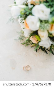 Classic wedding rings. Good photo of wedding detail. Shallow focus and some noise.