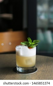 Classic whiskey sour cocktail, at the bar