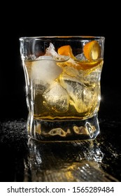 Classic whisky over ice in a traditional cut glass tumbler. Ice and beautiful highlights.