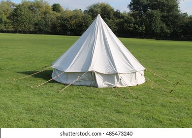A Classic White Canvas Bell Shaped Camping Tent.