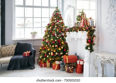 Classic white christmas interior background. New year snowed tree decorated with presents and flashing garland