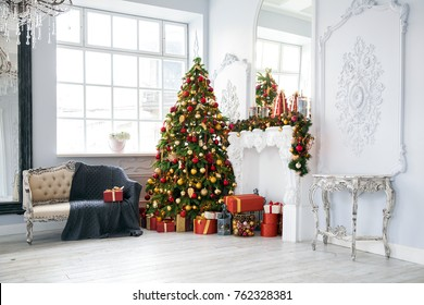 Classic white christmas interior background. New year tree decorated with presents and flashing garland