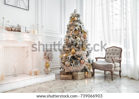 classic white christmas interior with new year tree decorated fireplace with grey chair clocks