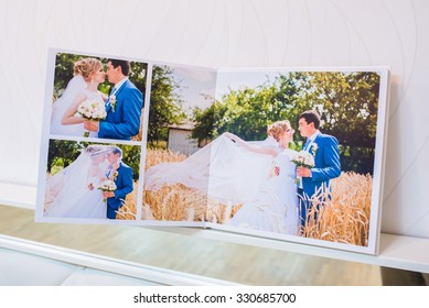 Classic white leather wedding photobook and album