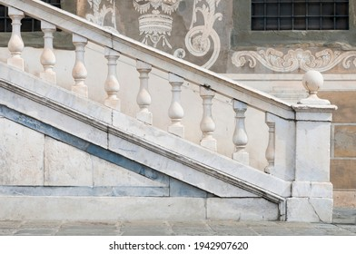 Classic white marble railing on the outside of an historic building in Italy