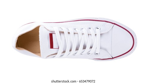 Classic white sneakers isolated on white background